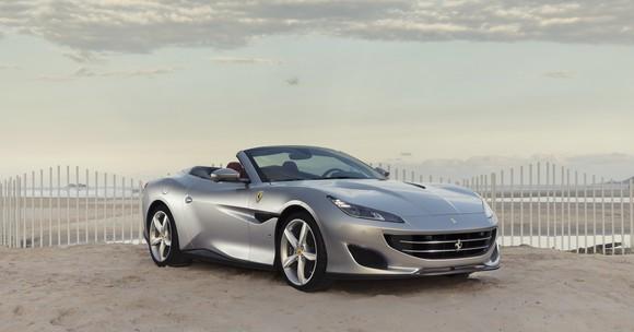 A silver Ferrari Portofino, a front-engined, four-seat convertible grand touring car.