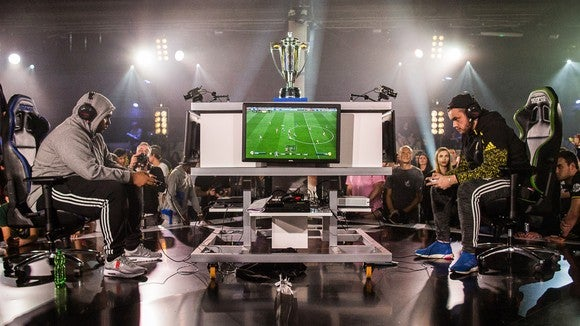 Two gamers face off during EA's FIFA esports tournament