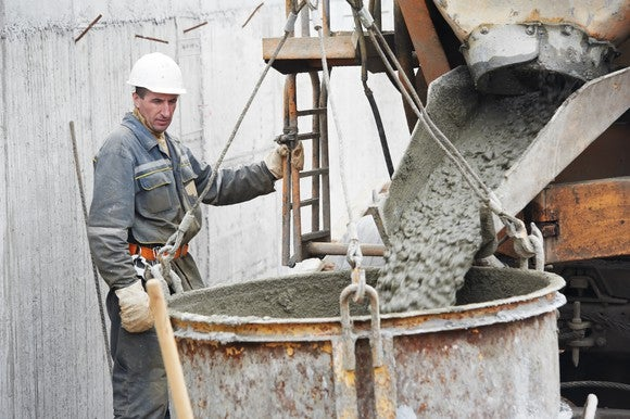 Man pouring concrete into form