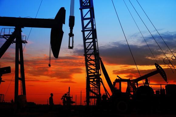 An oil field at sunset.