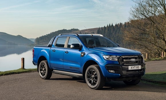 A blue Ford Ranger Wildtrak, a midsize pickup truck optimized for off-road use.