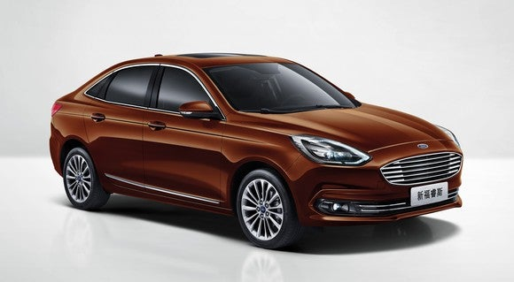 A brown 2018 Ford Escort, a compact sedan made for the Chinese market.