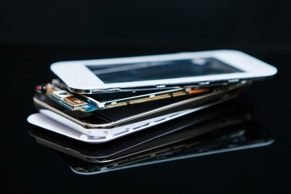 A stack of broken smartphones.