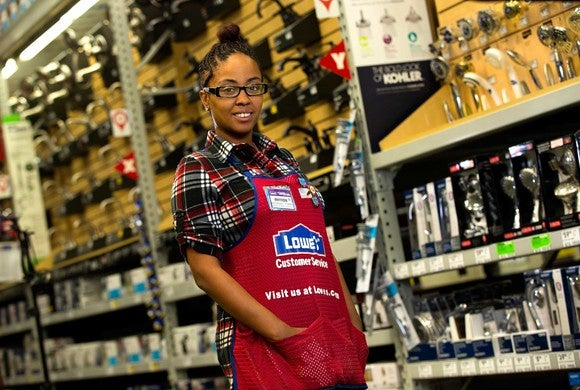 An employee standing in Lowe's fashion-fixture department