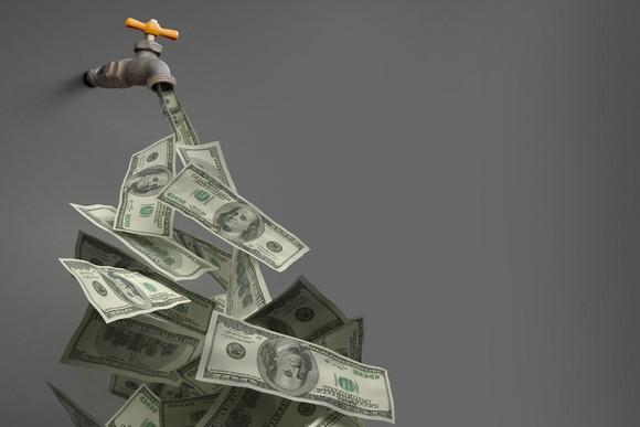 A spigot dispensing a stream of $100 bills