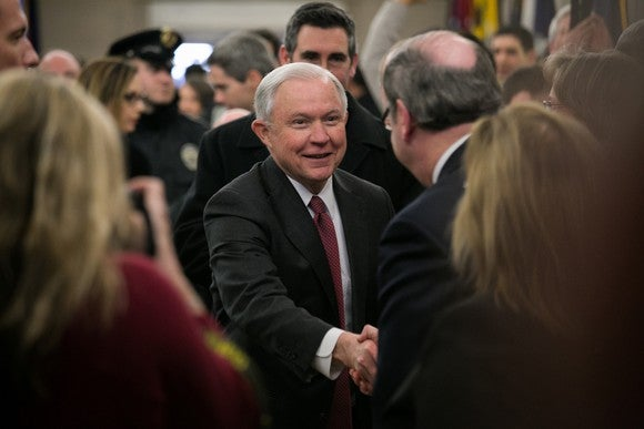 U.S. attorney general Jeff Sessions shaking hands