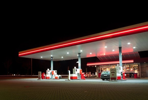 Gas station lit up at night.