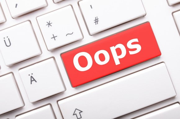 the word oops on a red key on an otherwise white keyboard
