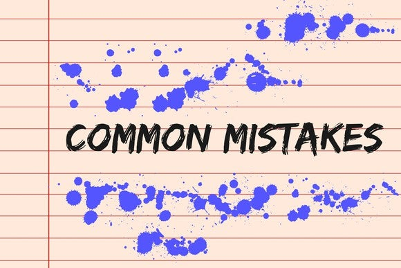 the words common mistakes written on a lined background, with spilled ink drops all around them