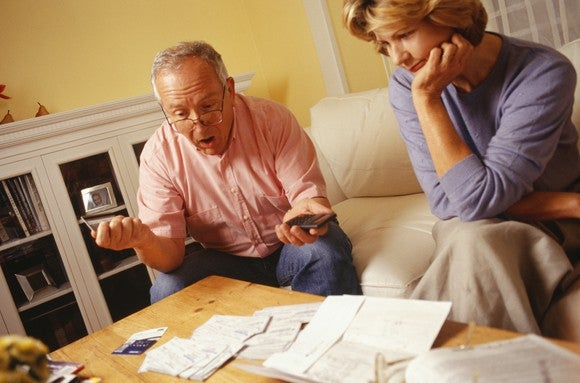 you can get an estimate of your expected benefits, an elderly couple sad and shocked by some papers