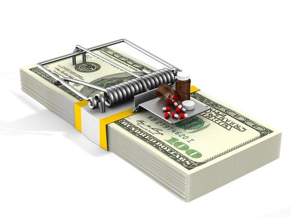 Stack of money arranged like a mousetrap with medicine as bait.