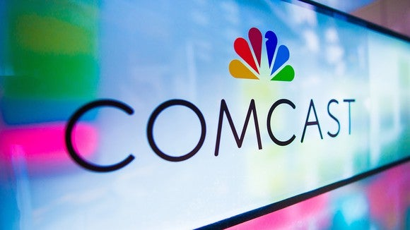 Comcast logo featuring the NBC peacock logo.