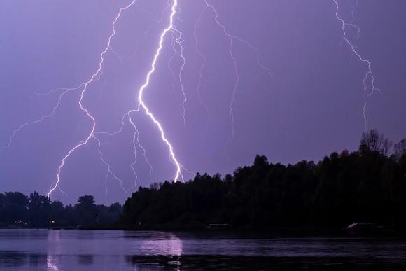Lightning strike against a purple sky