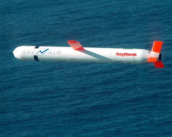 A Tomahawk missile flying over the ocean.