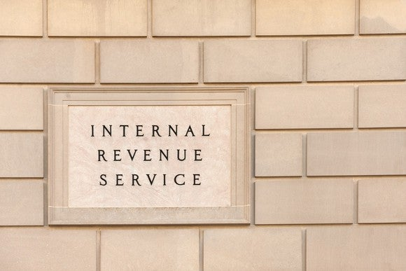 Brick wall with Internal Revenue Service nameplate on it.