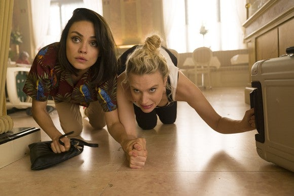 """Mila Kunis as """"Aubrey"""" and Kate McKinnon as """"Morgan"""" in the movie The Spy Who Dumped Me."""