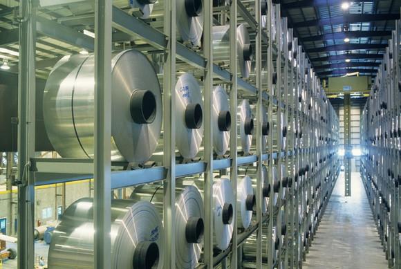 Aluminum rolls sitting in a warehouse.