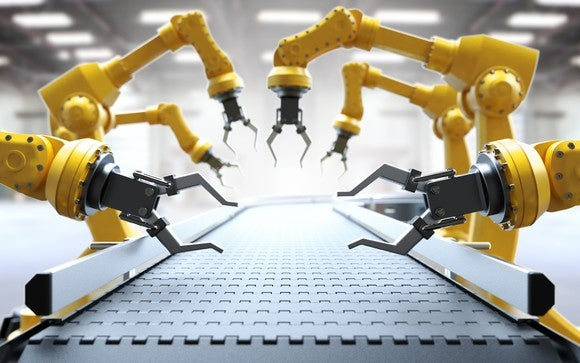 Robotic arms on a factory assembly line.