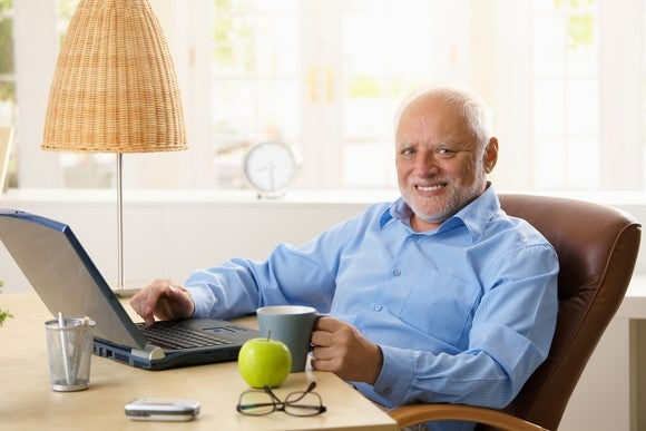Smiling older man at desk