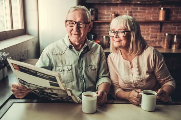 Senior couple reading a newspaper