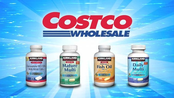 Costco logo above four bottles of Kirkland store-brand vitamins, against a blue background with streaks of light.