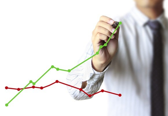 A businessman drawing a chart showing growth
