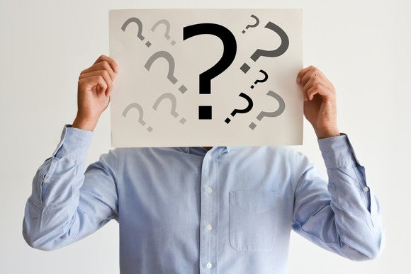 Man with question marks over his face