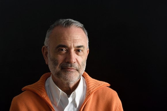Serious older man against a black background