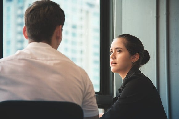 Young businesswoman talking to a businessman