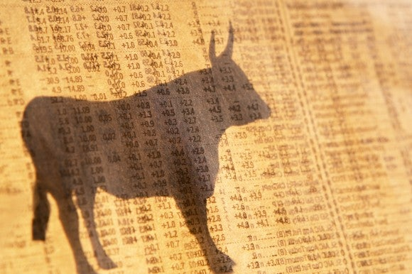 Shadow of a bull against a background of columns of numbers.