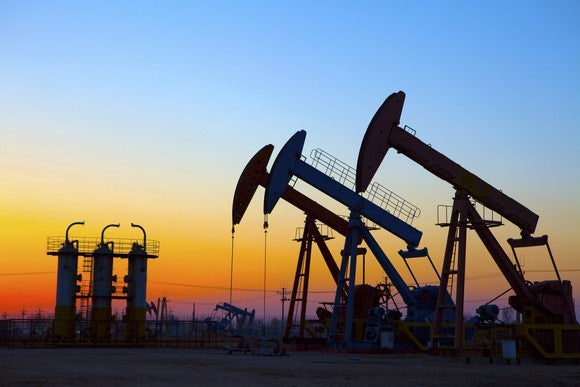 Oil pumping unit at sunset.