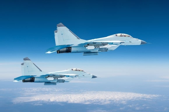Two military fighter jets at high altitude in the sky.