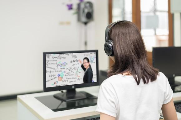 A woman takes an online class.