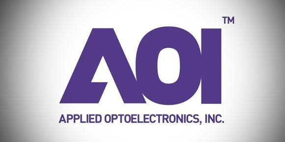 Applied Optoelectronics' corporate logo, purple on a grey gradient.