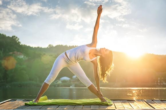 A woman holding a yoga pose.