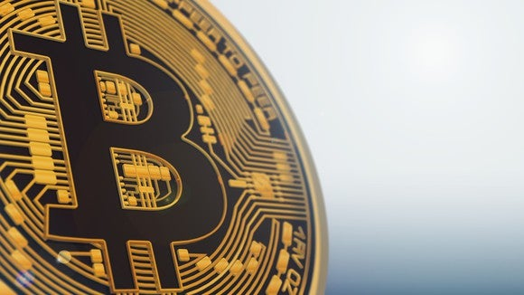 Opinion the sec dropped the ball on bitcoin and ether the motley a physical gold bitcoin up close stopboris Image collections