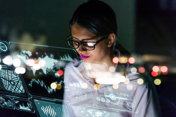 A woman views cloud-based data.