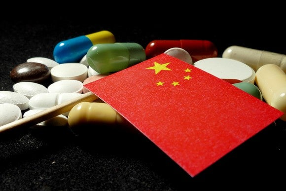 Chinese flag on a pile of pills.