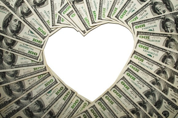 $100 bills arranged to form the shape of a heart