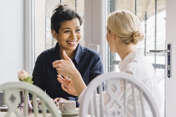 Two females talking