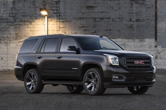 A black 2019 GMC Yukon, a big, upscale truck-based SUV.