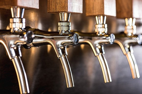 Close-up of row of beer taps in a pub.