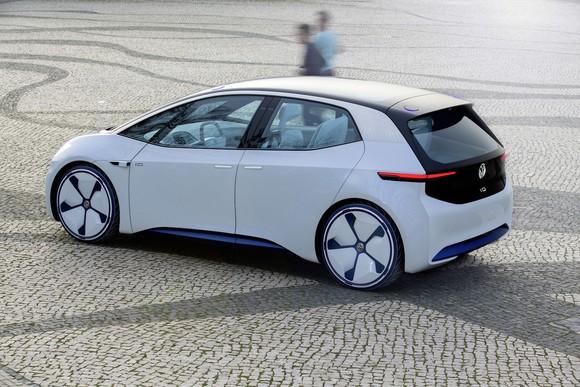The Volkswagen I.D. concept vehicle, a sleek-looking white hatchback
