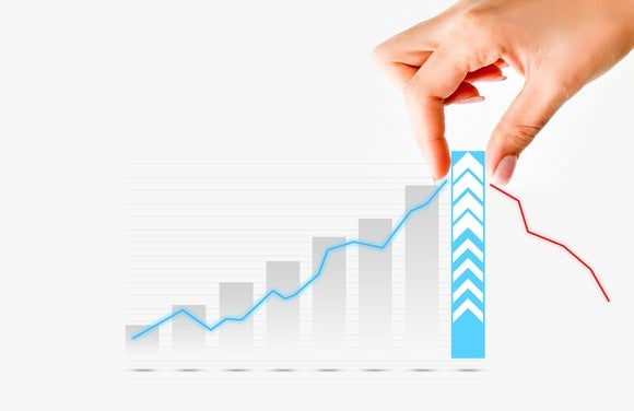 A hand pulling up the last and tallest bar in a bar chart showing growth.