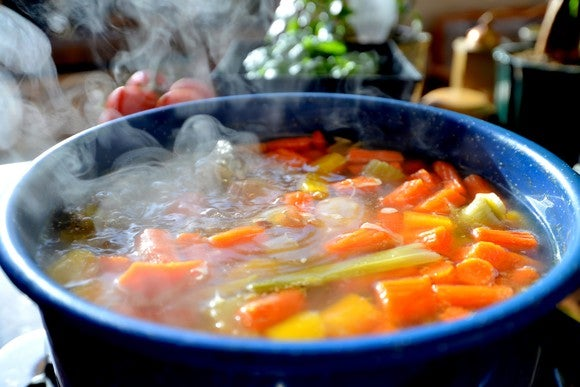 A steaming bowl of soup.