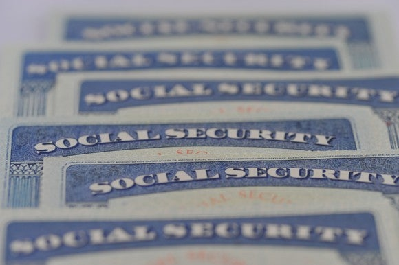 Social Security cards laid out on a table.