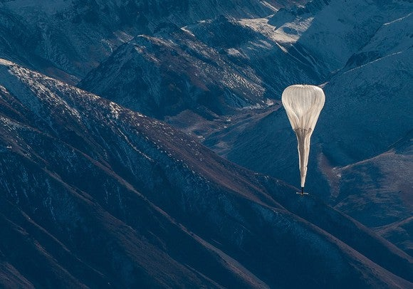 A Loon internet balloon floating over mountains