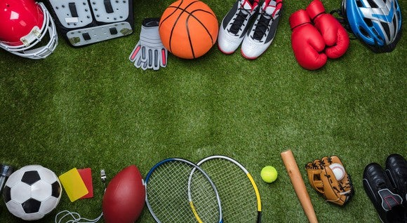 Sporting goods laid out on turf.