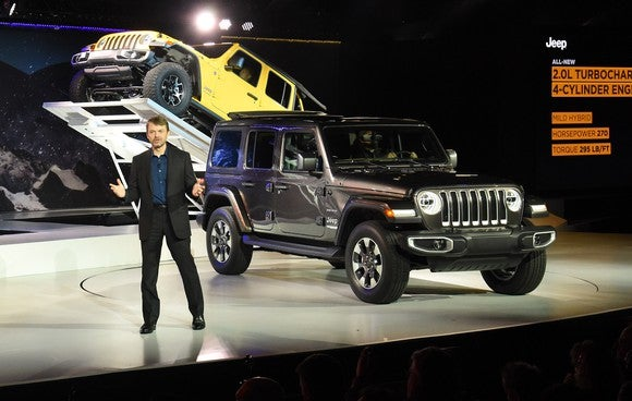 Manley is shown on an auto-show stage presenting the 2018 Jeep Wrangler.