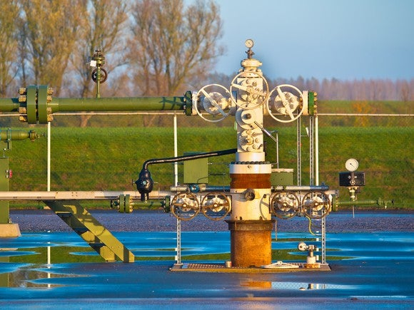 A natural gas wellhead after it rained.